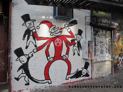 "Street art in NYC's East Village shows Santa Claus drinking alcohol and wearing an ""anarchy"" t-shirt"