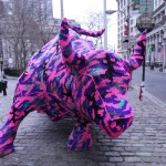 Polish artist Olek covered the Wall Street Bull in crochet as part of a guerilla street art piece.