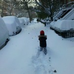 A child trudges through knee-deep snow in New York City after the December 2010 blizzard.