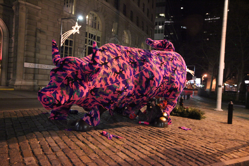 Street artist Olek covers Wall Street's &quot;Charging Bull&quot; in crochet as act of guerilla art.