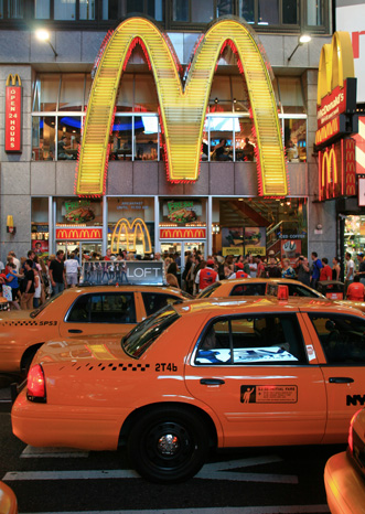Mc Donalds restaurant and taxis at NYC's Times Square
