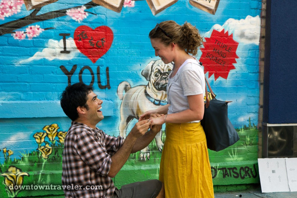 Man proposes to girlfriend with street art mural