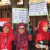 Young women in front of the Egyptian Museum in Cairo rally to promote tourism.
